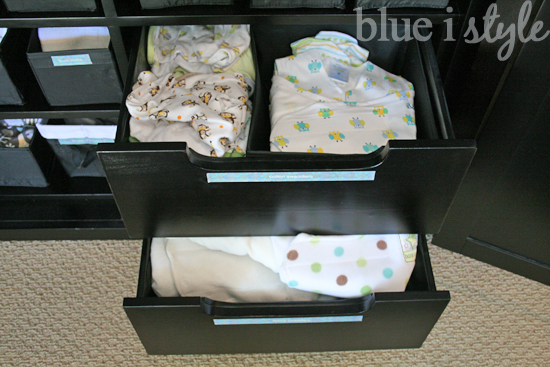 armoire drawers hold baby clothes and supplies