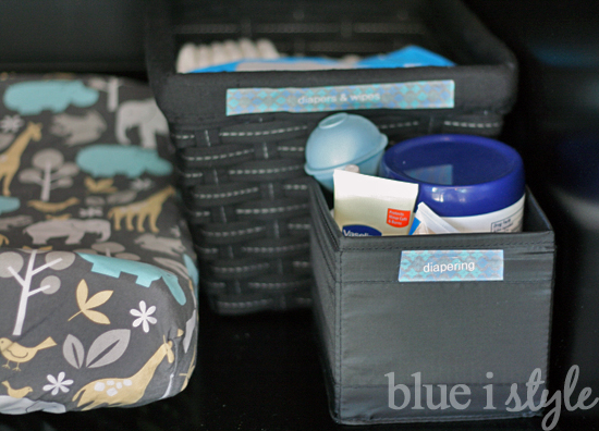 baby changing pad and diaper supplies in armoire