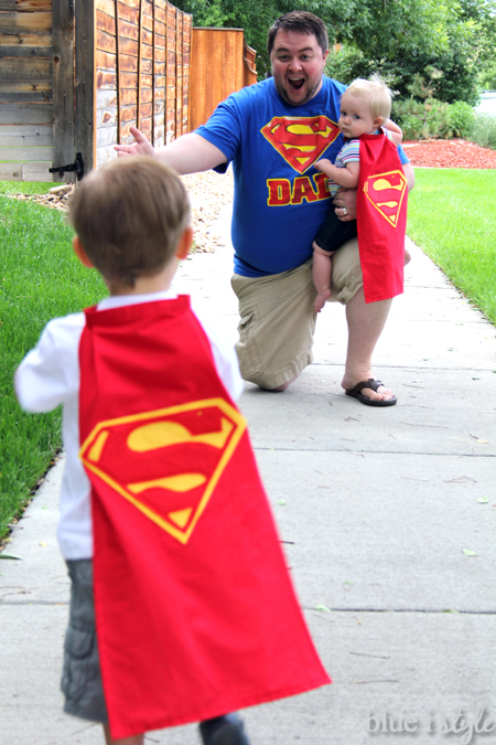 Dad in Superman tshirt, boys in Superman capes
