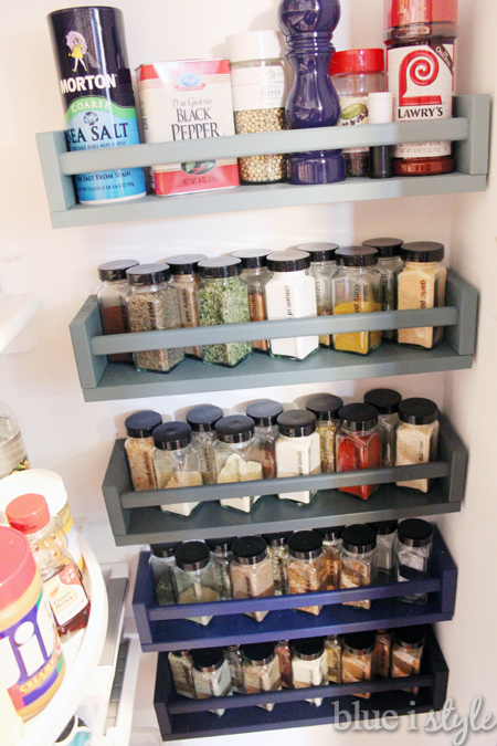 Ombre colored spice storage on unused pantry wall