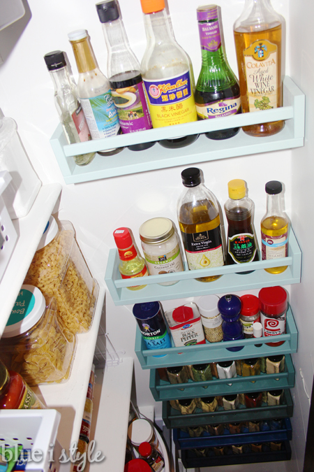Spice and oil shelves on pantry wall