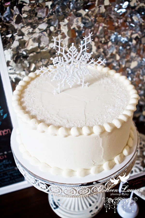 white cake with glitter and snowflake topper