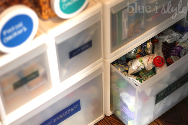 Drawers on floor of organized pantry