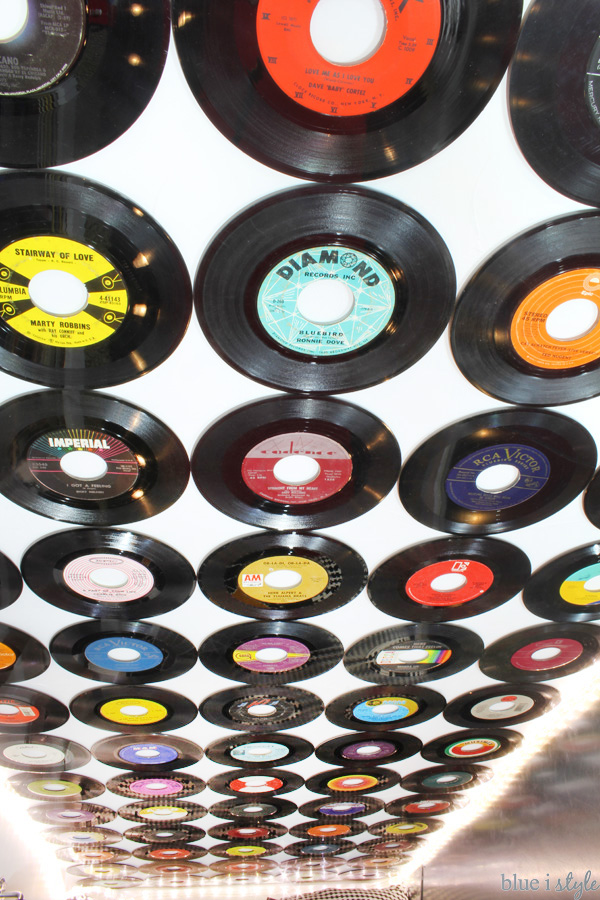A wall covered in vinyl records
