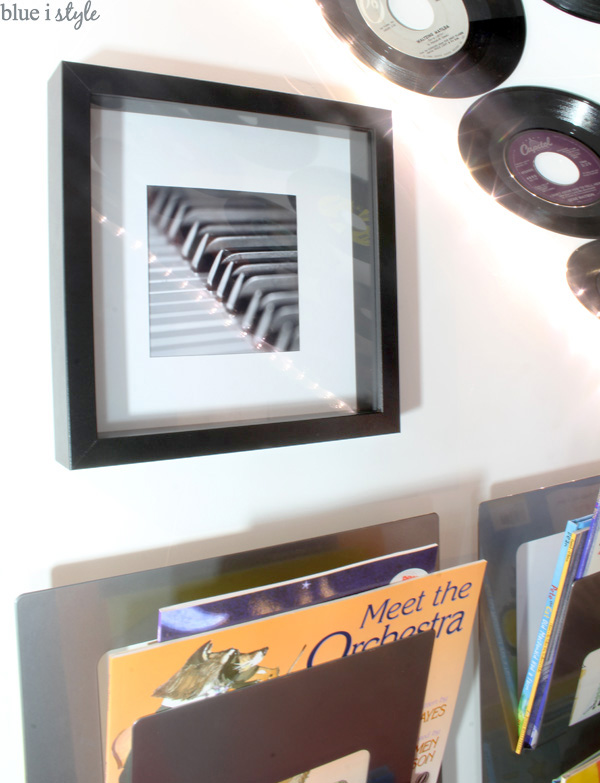 Framed photo of piano keys in a music themed playroom under the basement stairs.