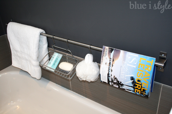 An Ikea rail makes for luxurious and stylish bathtub storage