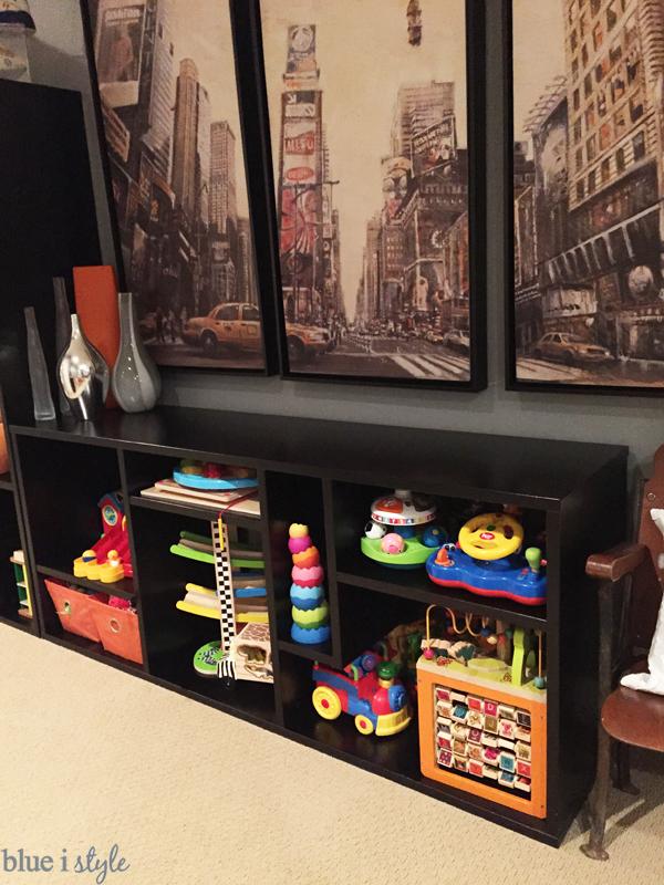 Toys stored on open shelves in family room