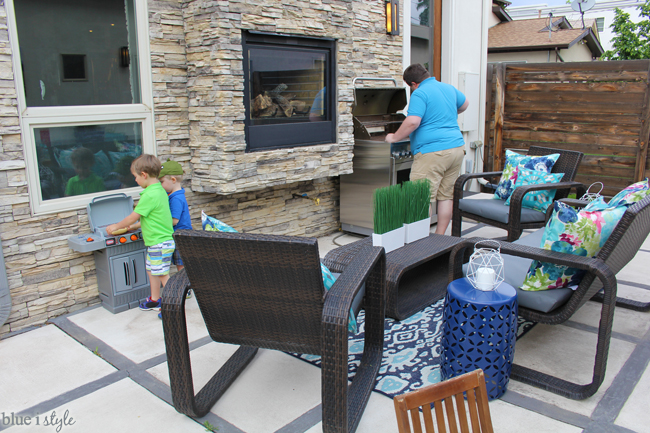 Kids play BBQ in backyard