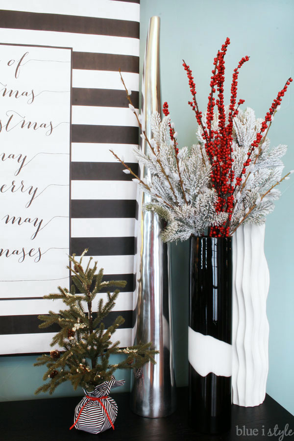 Christmas branches in tall vase