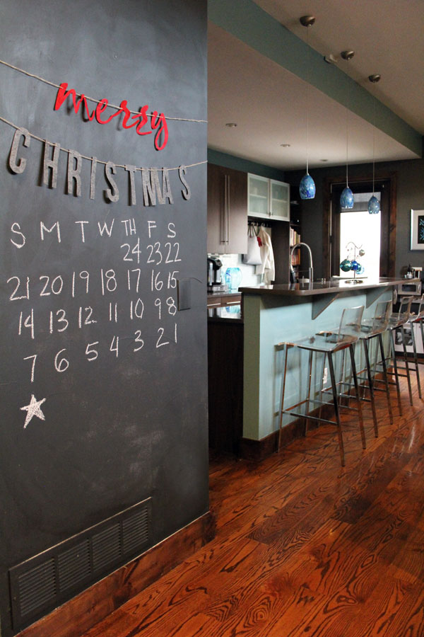 Christmas countdown calendar on chalkboard wall