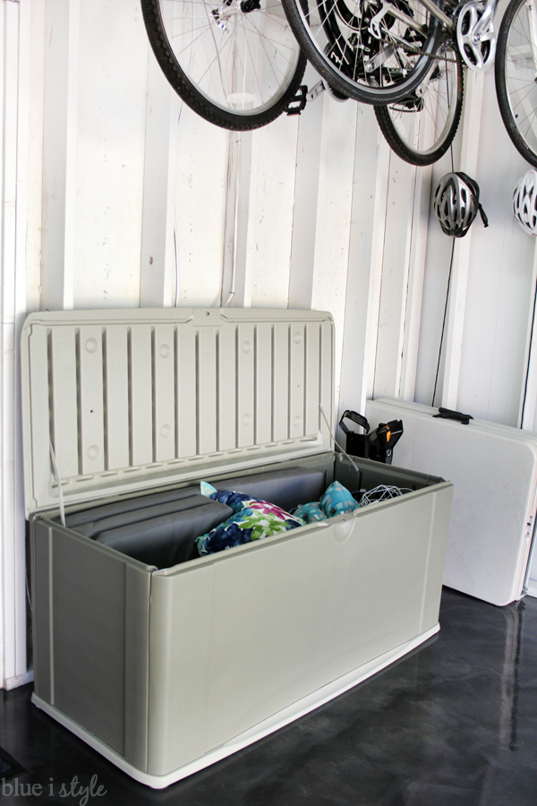 Deck storage box in garage for outdoor cushions