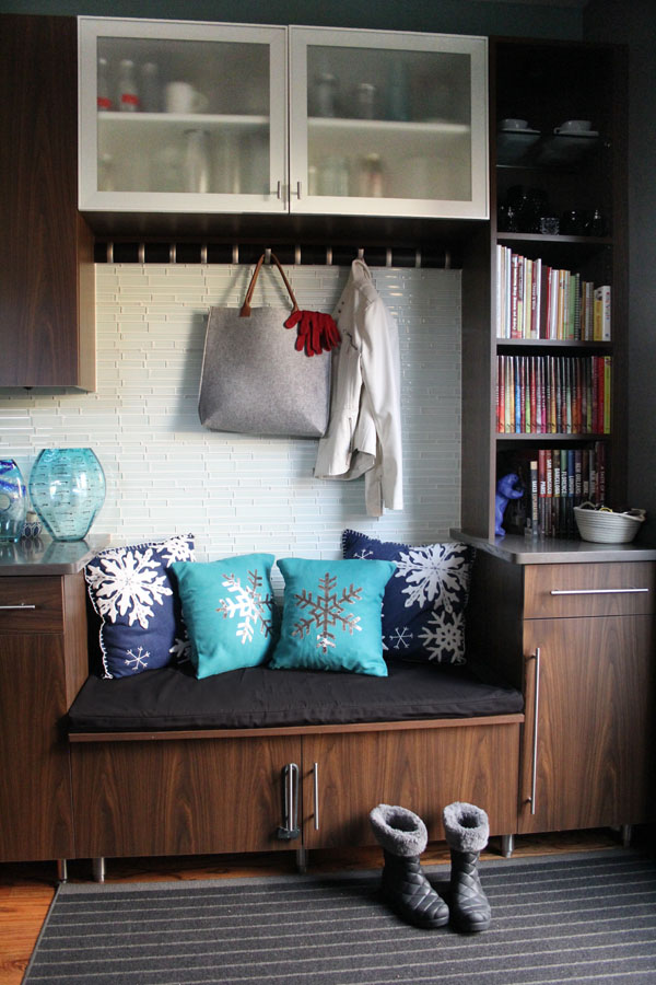 Christmas pillows in mudroom