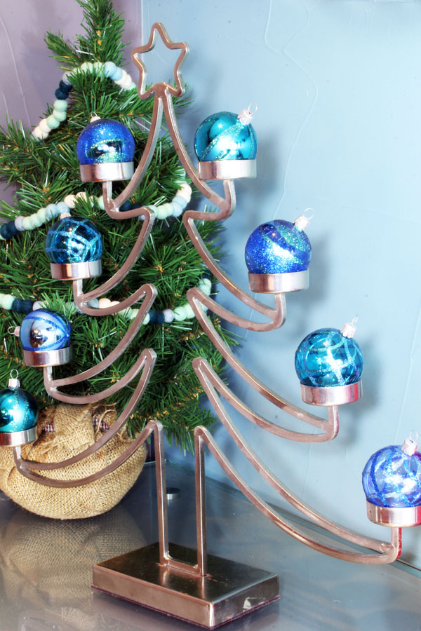 Modern metal Christmas tree with ornaments