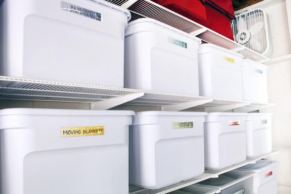 Elfa shelving in garage with matching white storage bins