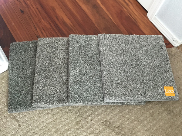 Comparing gray carpet swatches