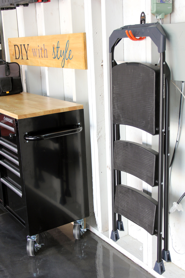 Hang step ladder in garage