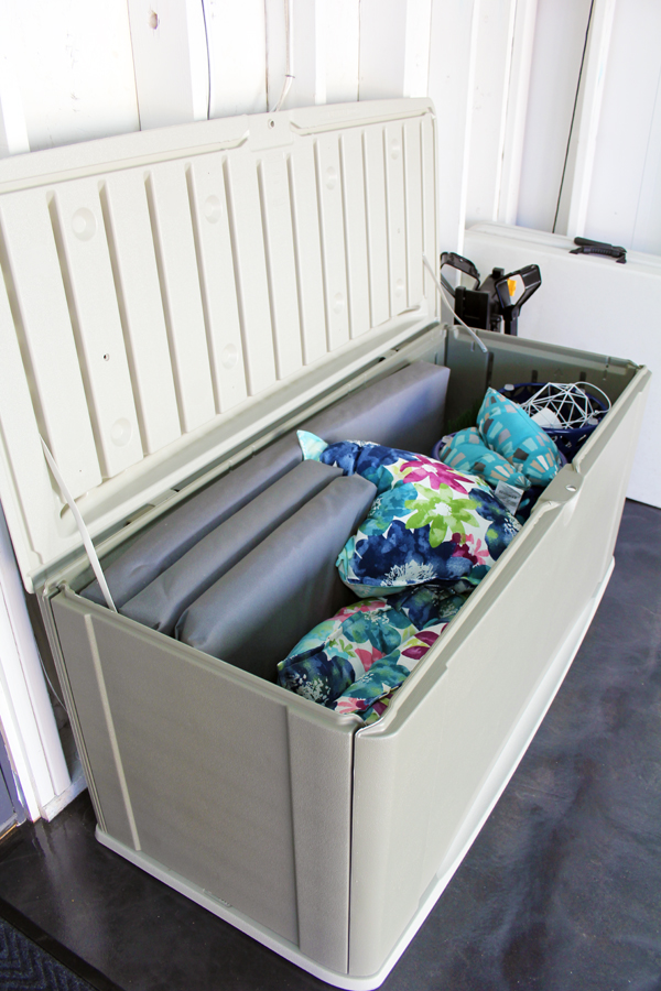 Store outdoor cushions and outdoor pillows in a deck storage box in the garage