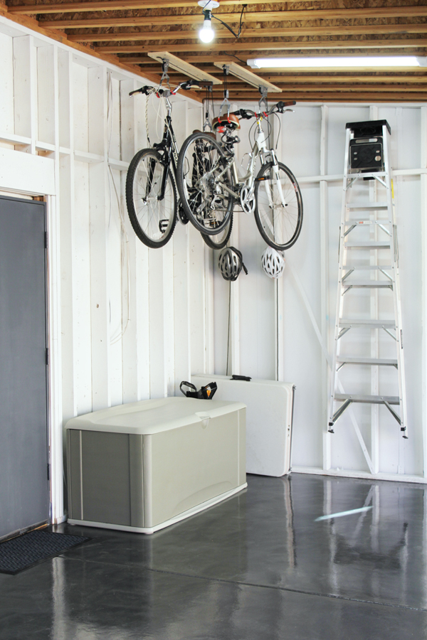 Use bike pulleys to hang bikes from the garage ceiling