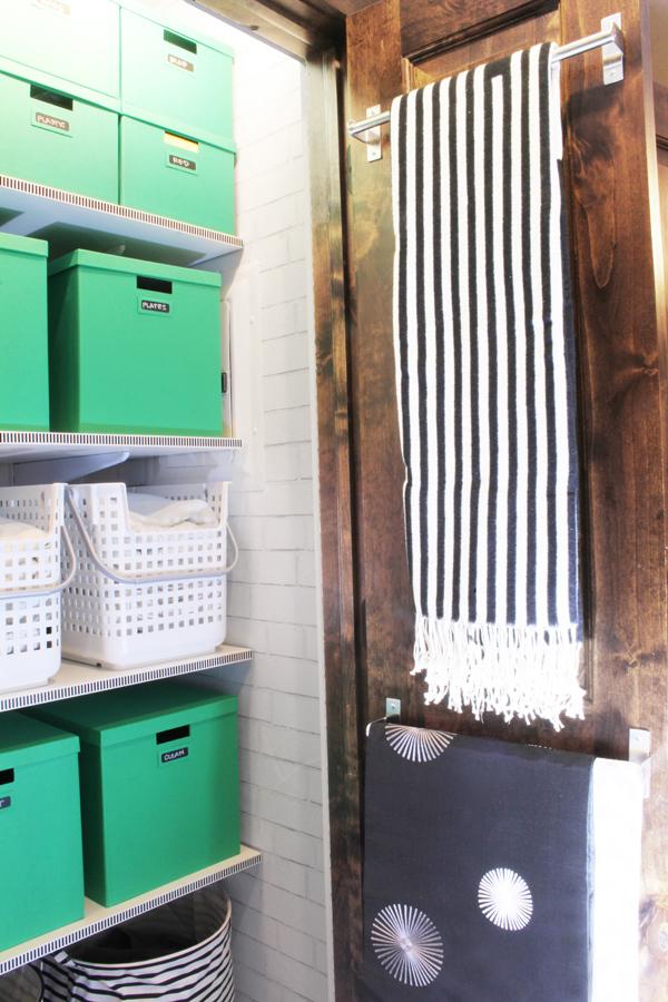 Towel Bars on Linen Closet Door to Hang Table Linens and Blankets