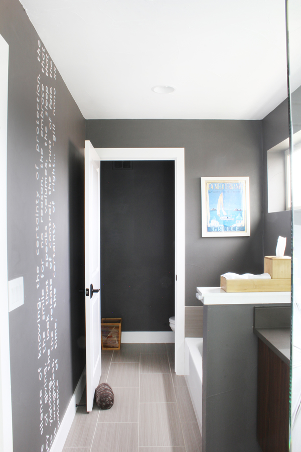 Gray walls in bathroom white trim. Cricut cut wall quote