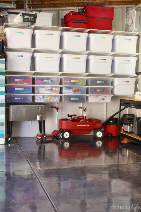 Organize the garage with a wall of adjustable shelves and drawers