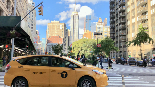 Taxi with Empire State Building in Background