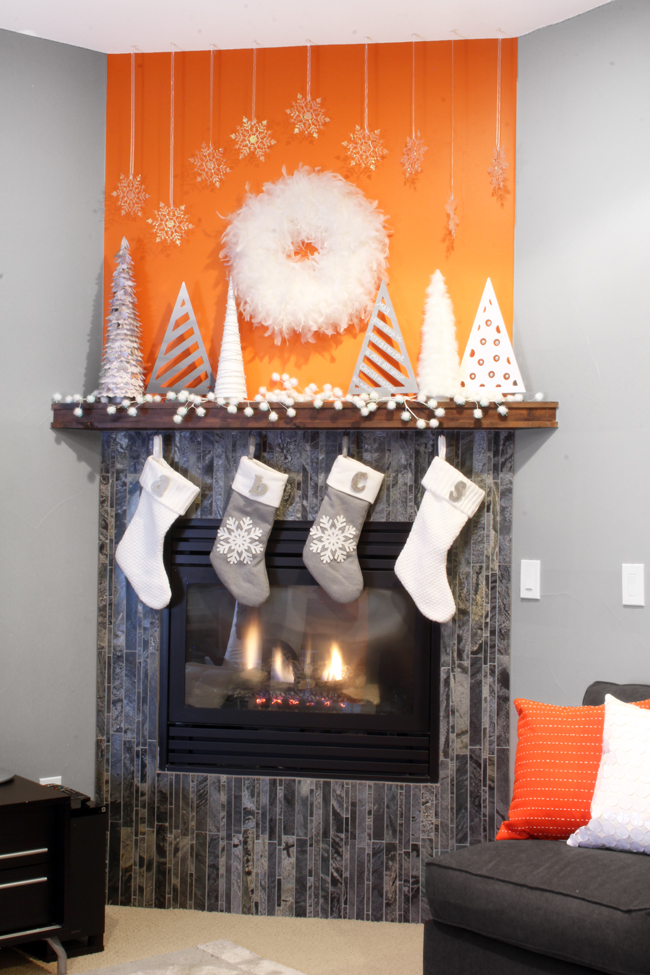 Glam and Modern White Christmas Mantel Display Orange Wall