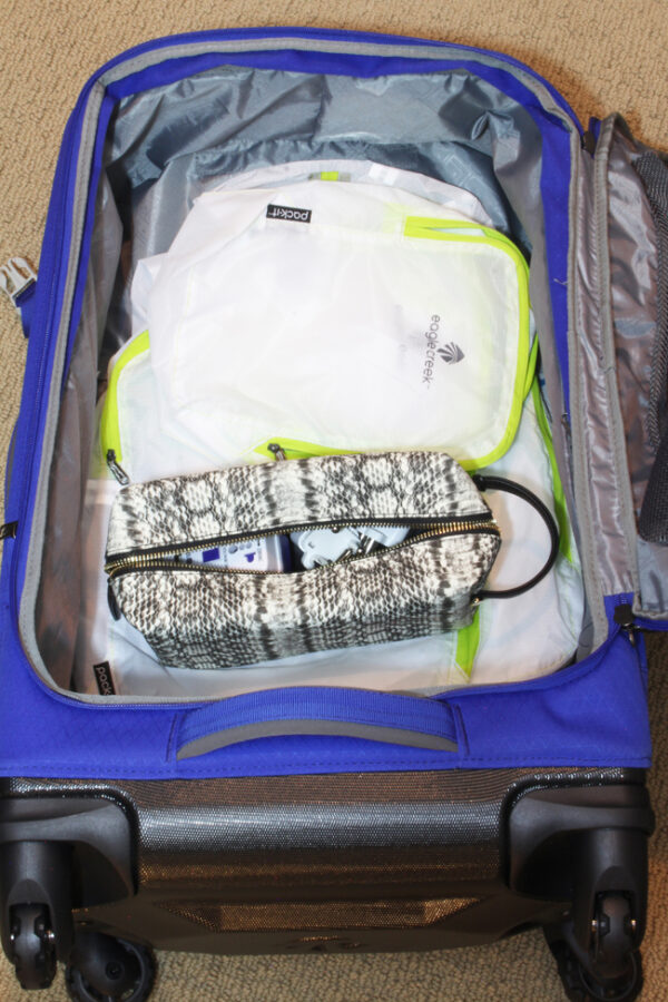 Store travel gear inside luggage