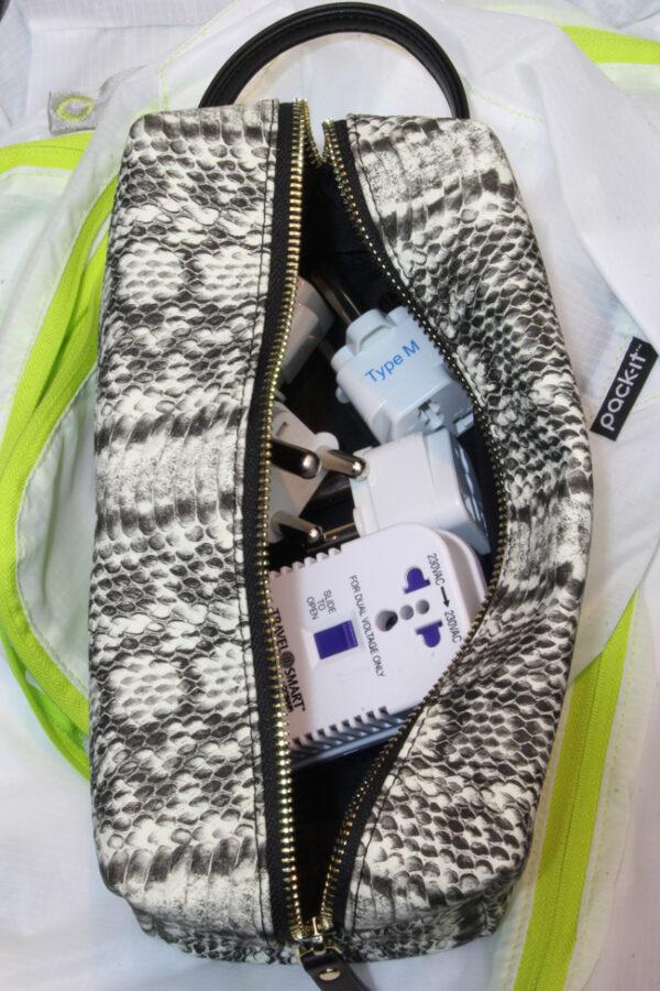Organize travel gear inside luggage