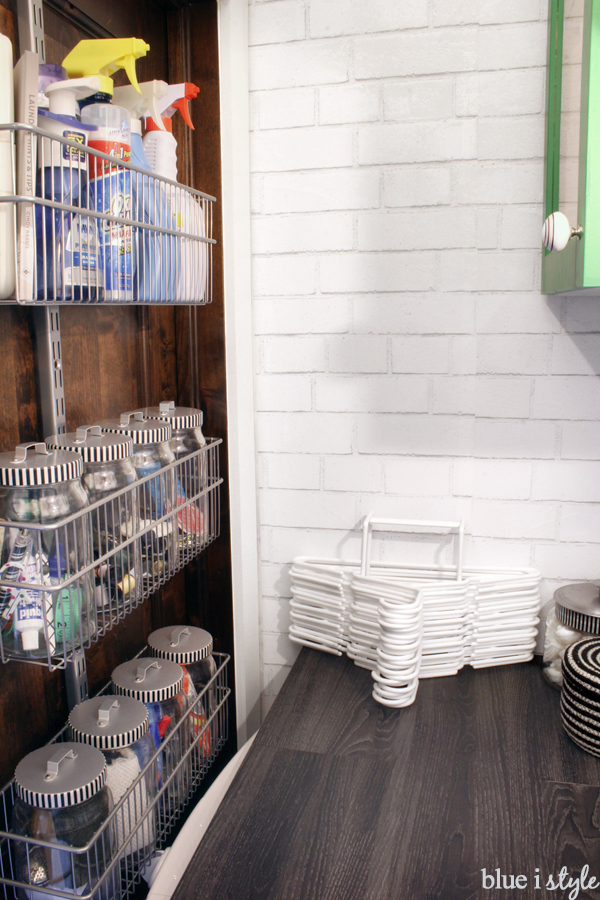 organize laundry supplies in back of door storage baskets