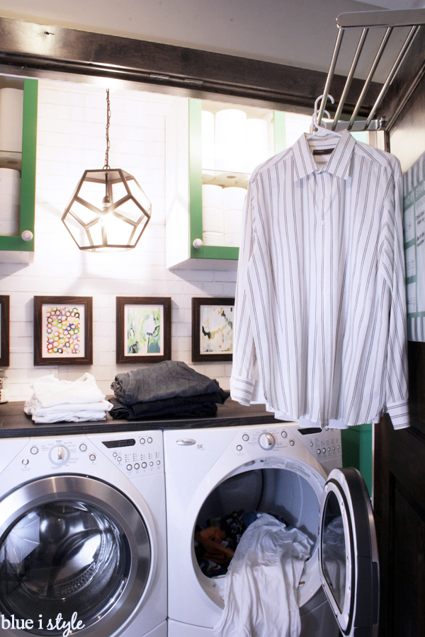 Space for folding and hanging clothes in a small laundry room