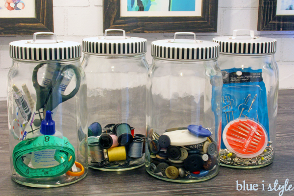 store extra buttons and sewing kits in glass canisters