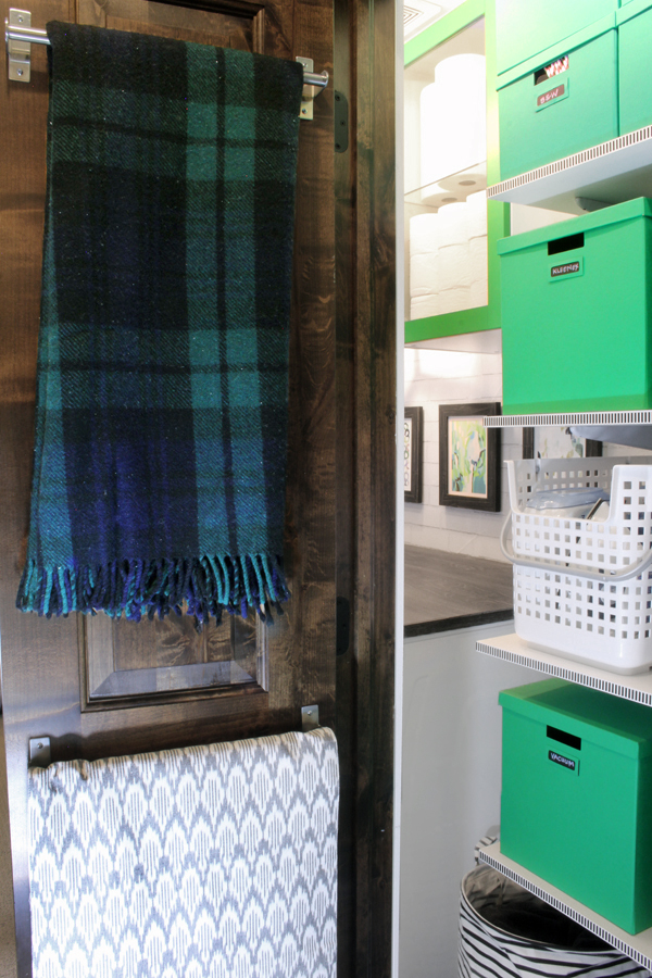 hang table linens and extra blankets on back of linen closet door