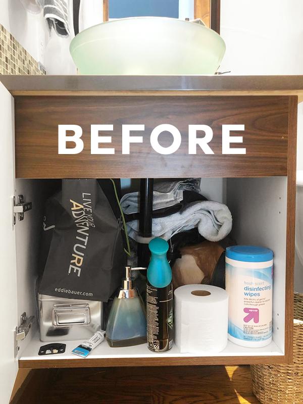 Messy before photo under bathroom sink