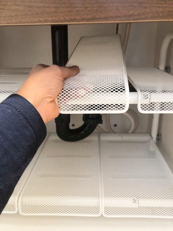 Adjustable shelving under bathroom sink