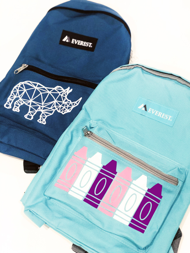 backpacks customized with rhino and crayons on their pockets