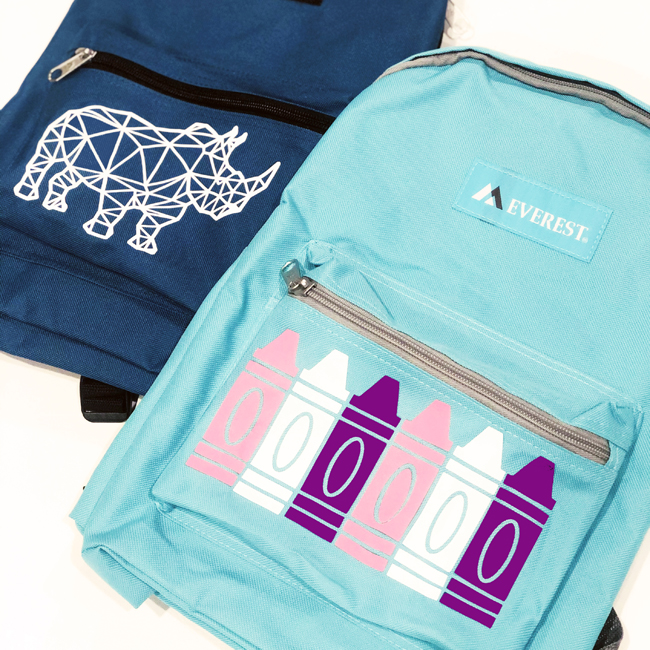 Square photo of backpack with rhino and backpack with crayons