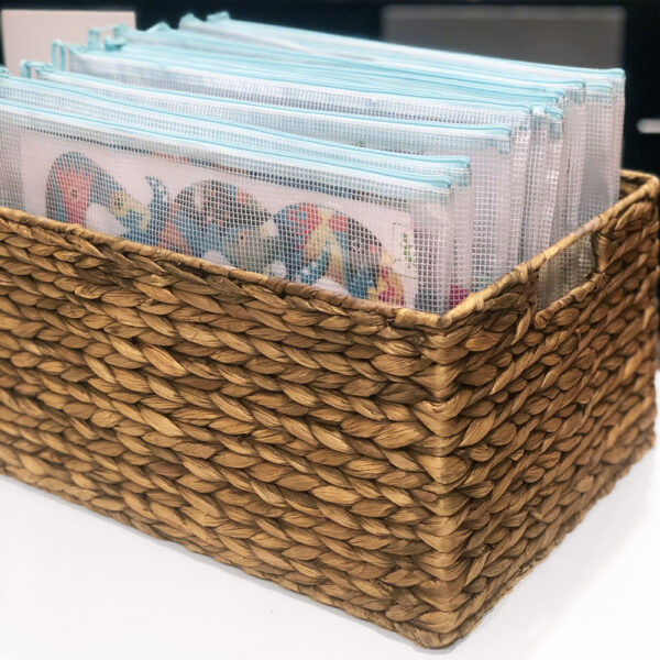 Organized puzzles in zipped pouches in a basket