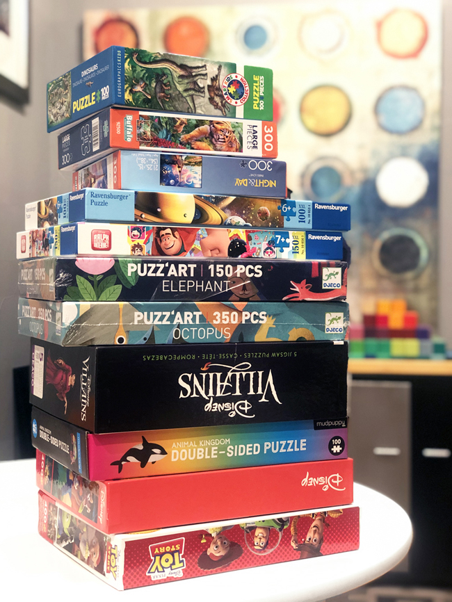 Stack of jigsaw puzzles in boxes