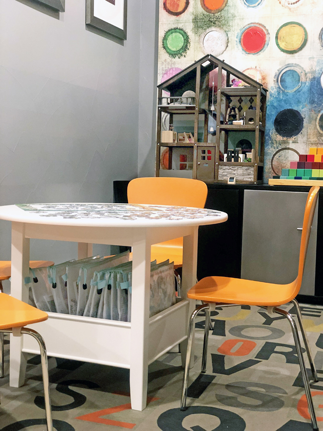 Storing puzzles under a play table
