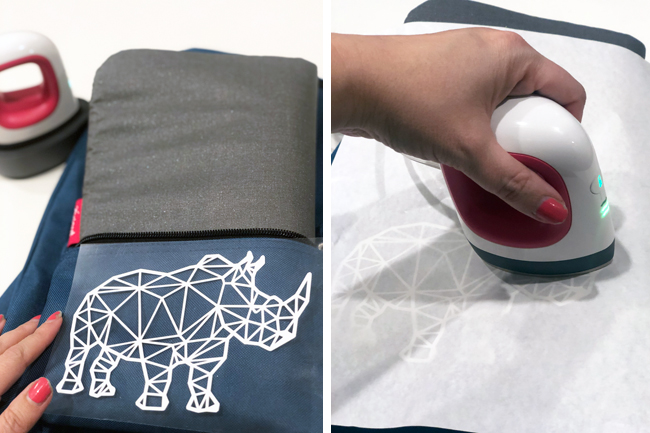 Placing an HTV rhino on the backpck and ironing it onto a backpack pocket