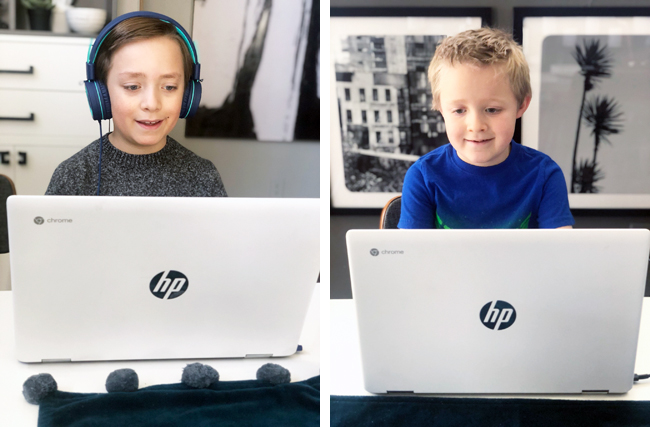 Boys doing school at home on matching Chromebooks