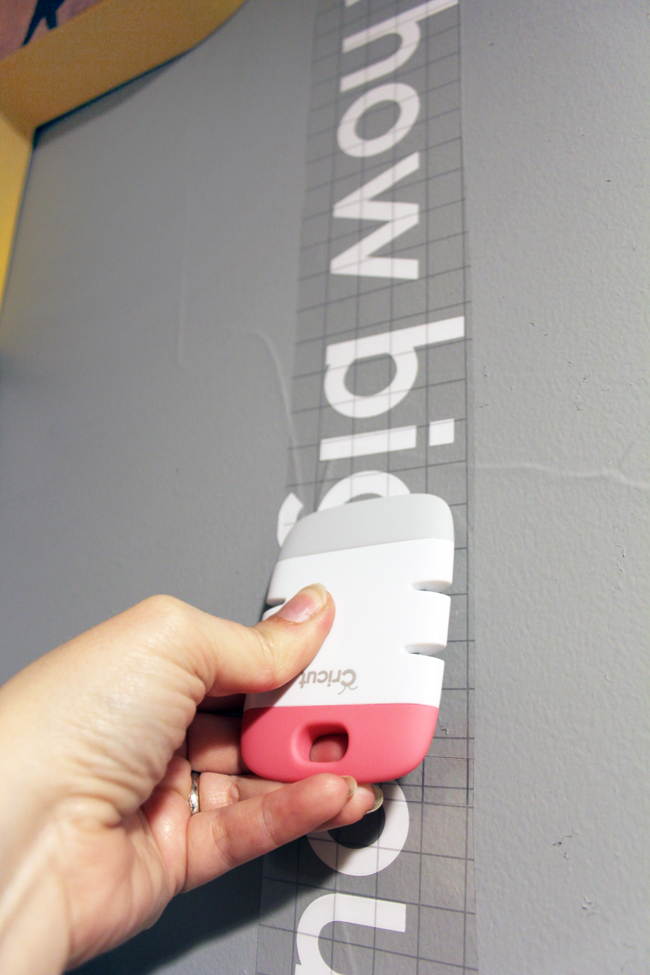 Burnishing vinyl wall quote using Cricut scraper tool