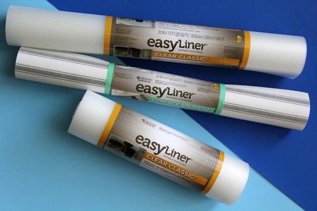 three rolls of Duck Brand easy shelf liner