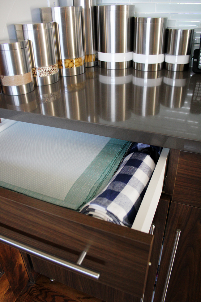 shelf liner cut to size of placemats in placemat drawer
