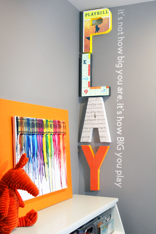 Large paper mache PLAY letters and vinyl wall quote about play from John Wooden