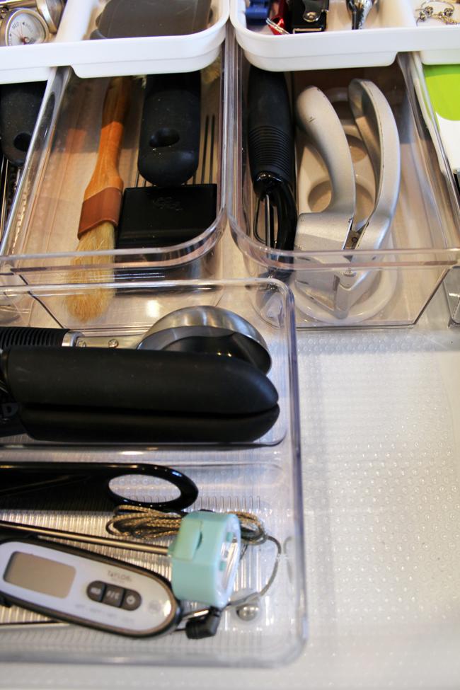 clear shelf liner below kitchen drawer organizing bins