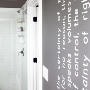 Modern Wall Words on Dark Gray Bathroom Wall