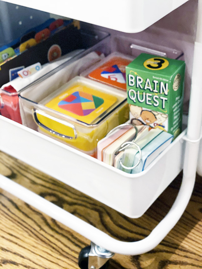 Osmo games on bottom shelf of cart