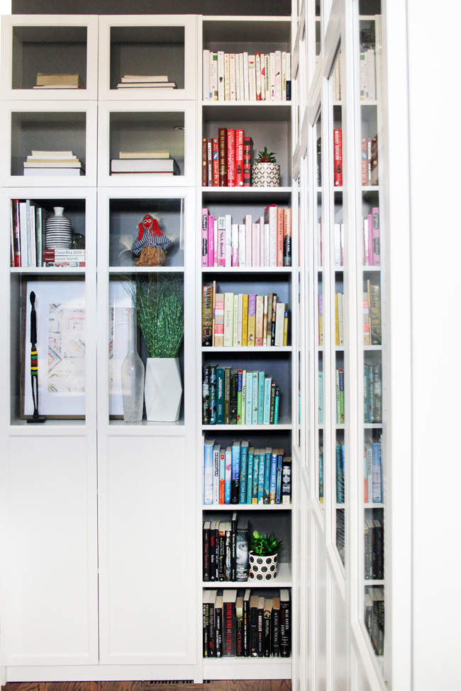 White Billy Bookcases in corner with glass doors